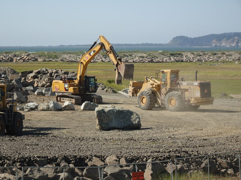 Machinery moving large boulders